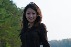 Wind in Her Hair (Chris-Creations) Tags: mei 20041030108 asian chinese woman wife girl beautiful beauty lovely smile fille bokeh sweater