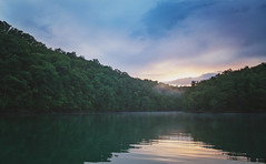 a quiet evening on the lake (Kathy Froilan | wandering.in.the.woods) Tags: mountain sky water tree forest lake serene landscape river dalehollowlake tennesseekentucky canoneos5dmarkii canonef24105mmf4lisusm sunset reflections ripple fog mist vacation