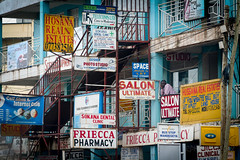 Nap time (micallrob) Tags: kampala napping man colour shapes urban buildings city shops stairs