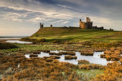 S.W. of Dunstanburgh Castle (Chris Lishman) Tags: dunstanburghcastle northumberland craster dunstanburgh castle iconic light clouds skies sea