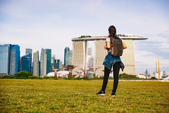 Female traveler standing at Singapore city (Patrick Foto ;)) Tags: action asia asian bay beautiful blue building carefree cheerful city cityscape concept couple famous fashion female freedom fun girl grass group happy high holiday joyful jumping life lifestyle marina motion outdoors people person place portrait relax senior singapore sky standing style tourism tourist travel traveler urban women young sg