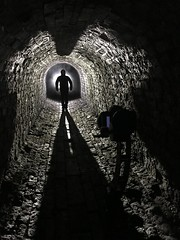 Behind the scenes... (Waving lights in the dark) Tags: iphone bts behindthescenes dark afterdark night backlit backlight backlighting texture brickwork stone tunnel lightpainting