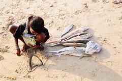 No Love for baby sharks (againandagain251) Tags: india immaturesharks fishingcatch puri orissa beach sand kid indiangirl fish loveheart doddle oldfilm backcatalogue travelling incredibleindia