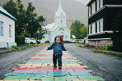 henry in iceland, part one (manyfires) Tags: henry baby toddler child boy son kid family iceland europe vacation travel nikonf100 35mm film analog church thebluechurch run seydisfjordur easticeland easterniceland portrait