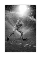 cooling down (Istvan Penzes) Tags: leicammonochromtyp246 leicasummicron90mm penzes manualfocus rangefinder availablelight handheld bw black white child lego lucas family