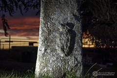 Tara Sheela-na-Gig (mythicalireland) Tags: statue stone standing megalith monolith hill tara county meath red sky sunset dusk evening clouds flash carving sheelanagig goddess female