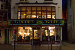 Golden Grid in Scarborough at night (Tony Worrall) Tags: yorkshire yorks scene scenery northyorkshire resort yorkshirephotos east eastern scarborough seasidetown dark night architecture building urban update place location uk england north visit area attraction open stream tour country item greatbritain britain english british gb capture buy stock sell sale outside outdoors caught photo shoot shot picture captured goldengrid frontage shop chippy chips fastfood eat cafe food windows light lit shine