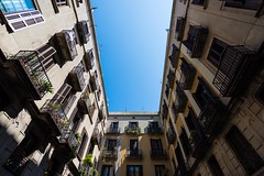 Look-up (alexpekone) Tags: architecture architectura archicture architecte city cityview cityscape blue sky bluesky art nikon photography photographie ville rue street streetview windows building buildings barcelone barcelona catalogne cataluna catalonia catalunya perspective lookup lookingup look up