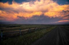 Summer Thunderstorms (Kim Tashjian) Tags: sky clouds storm summer fence montana road