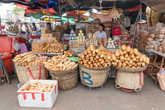 Bread Stall, Siem Reap, Cambodia (DavidGabis) Tags: dry natural asia street foodstuff shop city brown bread foody baguette basket loaf life bakery meal destination organic wood golden women market group many wooden abundance thirdworld phnompenh breakfast travel rural acitivity healthy exotic diet tropical bananas food khmer cambodia french product traditional freshness wheat siemreap fresh stall pastry working