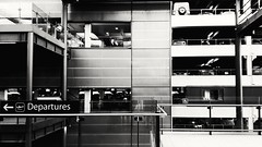 Gatwick Airport : Happy Holidays..... (markwilkins64) Tags: markwilkins gatwickairport airport departures mono monochrome blackandwhite bw carpark contrast railings londonairport gatwick architecture design modern contemporary multistorey