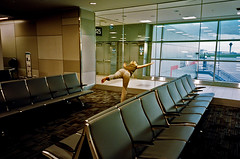 Departure Lounge, Toronto Airport (deepstoat) Tags: ricoh grs film kodakportra400 street analogue buyfilmnotmegapixles sparks unbound unbounders photobook streetphotography 35mm ibelieveicanfly ambitious superwoman stretch yoga