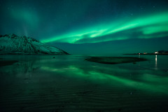 Lights in a dark fjord (eriknst) Tags: aurora fjord blue green northern lights night shot landscape seascape astrophotography nikon sirui 1424mm senja norway norwegen norvege winter solitude peaceful silence