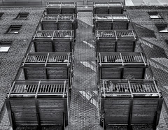Extra rooms (David Feuerhelm) Tags: bw nikkor blackandwhite contrast noiretblanc schwarzundweiss building balcony lowviewpoint perspective bricks london street city nikon d750 2470mmf28
