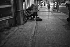 Queen & Dunn (alisdair jones) Tags: summiluxm11435asph man guitarist guitar busker musician nylon string queen street parkdale toronto leica m240