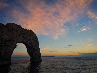 Lovely sky over the arch at Durdle Door, Lulworth, Jurassic coast, Dorset, UK.