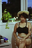 Anna, 2018 (TheJennire) Tags: photography fotografia foto photo canon camera camara colours colores cores light luz young tumblr indie teen people portrait 50mm 2018 curlyhair hat summer plant room home window cozy strawhat makeup woman body boudoir girl eyes look