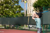 Boy with critical focus and determination striking tennis ball o (blurMEDIA Stock) Tags: florida active activity aerobic athletic boy cardio child childhood competition concentration court exercise family friendly green healthy hit holiday learning leisure lesson net outdoor outdoors racket racquet relax skill son sport sports summer sunshine tennis tennisball vacation vision warm young youth usa