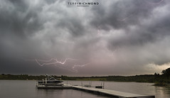 Lightning Flash (Terry L Richmond) Tags: water sky river lake storm cloud rain nature outdoors weather harbor landscape dock outdoor pier waterway boat noperson loch cloudy large atmosphere clouds body port dawn calm day waterfront reflection tree traveling sunset meteorologicalphenomenon docked dark steam dramatic evening mountain travel horizon sea floating lightning cumulus bridge thunderstorm plutotrigger