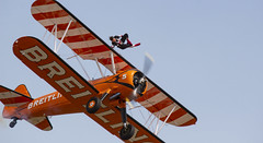 The Flying Circus Wingwalking Team, Shuttleworth Collection Family Air Show, Bedfordshire (IFM Photographic) Tags: img4017a breitlingstearman breitling stearman theflyingcircuswingwalker wingwalker wingwalking nikita aerosuperbatics canon 600d sigma70200mmf28exdgoshsm sigma70200mm sigma 70200mm f28 ex dg os hsm apo tele converter 2x af teleconverter oldwarden bedfordshire beds shuttleworthcollection shuttleworthhouse familyairshow airshow aircraft aeroplane plane airplane boeing