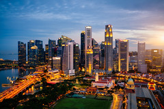 Aerial view of the Singapore landmark financial business district at twilight sunset scene with skyscraper and beautiful sky. Singapore downtown (MongkolChuewong) Tags: aerial aerialview architecture asia bay building business city cityscape district dome downtown drone exterior famous ferris flyer garden hotel landmark landscape laser light marina night panorama park river sands sea show singapore singaporecity singaporean sky skyline skyscraper southeastasia sunrise sunset tourism tower travel traveler twilight urban view water waterfront wheel