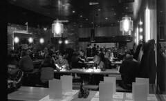 Through a restaurant window. Film 78 (21)edit (richardhunter3) Tags: olympus om1 ilford delta 3200 push street people restaurant night candid eating food camberley oracle