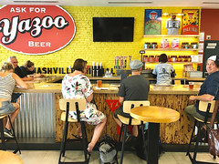 """Killing Time"" (Halvorsong) Tags: sign signs beer pub tavern travel airport color yellow red people composition art life city urban nashville usa america americana fun dailylife explore discover restaurant wall walls brick travelers world culture contrast relax relaxation time halvorsong"