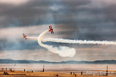 Breitling Wingwalker Biplanes (Adrian Evans Photography) Tags: smoketrails breitling sand landscape sunset northwales uk people rhyl propeller biplane airshow evening aircraft clouds outdoor wales irishsea coastline smoke water plane adrianevans british sky breitlingwingwalkers seascape display coast beach sea