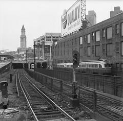 MBTA PCC Trains from NorthSta 9-28-1970 (ironmike9) Tags: trolley tram streetcar pcc transit publictransit rail track lightrail mbta bostonma tower skyscraper subway portal tunnel billboard