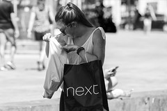 What's next? (Frank Fullard) Tags: frankfullard fullard candid street portrait lol next store bag lady monochrome blackandwhite galway irish ireland look lost