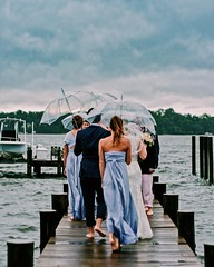 rainy wedding (eva michie) Tags: umbrella happy cool interesting landscape ocean water skies blue weather rain wedding portrait family awesome photography storm canon digital camera