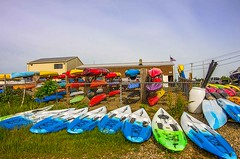 Kayaks for Rent! (Bud in Wells, Maine) Tags: maine vacationland wells wellsharbor fence kayaks recreation webhannetriverboatyard colors hss