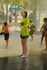 Embracing the shower (radargeek) Tags: internationalmudday okc oklahomacity myriadgardens downtown kid kids child children spray shower june 2018