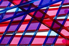 Plastic - Macro Mondays (Crisp-13) Tags: macromondays plastic macro mondays red blue purple handle spoon ice cream backlit