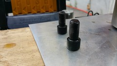 Both bolts cooling after rustproofing (JD and Beastlet) Tags: rustproofing rusty mirror bolts garage process delboys