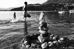 Static And Movement (Luca Bobbiesi) Tags: blackwhite biancoenero bienne bw portrait lake lagodicaldonazzo boy play gioco stone trentinoaltoadige fujix100 une