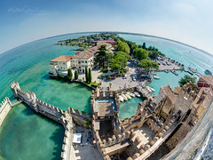 Anyone claims the Earth is flat? (Karsten Gieselmann) Tags: 8mmf18 blau burg em5markii europa exposurefusion farbe fisheye gardasee grün italy jahreszeiten lagodigarda lakegarda mzuiko microfourthirds olympus reise seeteichweiher sommer sonne türkis wetter blue castle color green kgiesel lake m43 mft pond seasons summer sun travel turquoise weather sirmione lombardia italien