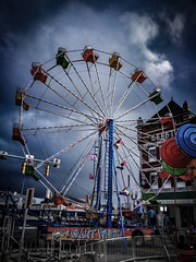 Carnival rides in a storm during the annual 2018 Circus City Festival in Peru, Indiana. (DM Photography - Dan Mongosa) Tags: weather circus carnival ferriswheel peru indiana festival fair thunderstorm clouds evening dark stormy storm neon glow