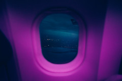 love her from the get-go, pick her up from heathrow (Louis Dazy) Tags: window seat plane flight pink sky dark night city skyline