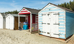 Working on the Beach (Rachel Dunsdon) Tags: westsussex beachhuts working man computer sheltering shade warm