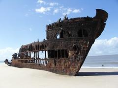 Ship carcass (daveandlyn1) Tags: ship carcass skeleton beiera mozambique m400r finecam kyocera digital sea beach people clouds
