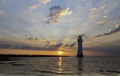 Sunburst...... (gmorriswk) Tags: lighthouse formatthitechreverse06grad fortperchrock newbrighton rivermersey seascape landscape lightrays lightray sunrays sunlight clouds sunburst sunset