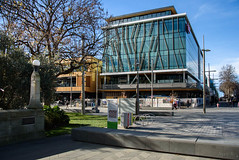 Soon Be Open for Business (Jocey K) Tags: newzealand nikond750 christchurch cbd city architecture buildings trees shadows sky signs autumn people rebuild terracedevelopment