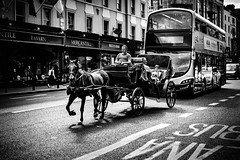 Technology (Kieron Ellis) Tags: horse cart horsecart buggy people boy bus road flag traffic candid blackandwhite street blackwhite monochrome