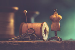 Sewing Souvenir (Ro Cafe) Tags: mm macro macromondays trinkets charms sewing spools pin dark lowkey light nikkormicro105f28 nikond600 scissor minimannequin
