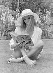 The title of the book is not as black & white as it seems... (mlcphotography666) Tags: blond story model lady beautiful blackandwhite read garden hat book