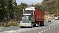Federal Highway Flyers (2/4) (Jungle Jack Movements (ferroequinologist)) Tags: canberra act australian capital territory federal highway moloney gippsland victoria kenworth sims metal freightliner vv 45iu baugh hilltop nsw cope hp horsepower big rig haul haulage freight cabover trucker drive transport carry delivery bulk lorry hgv wagon road nose semi trailer deliver cargo interstate articulated vehicle load freighter ship move roll motor engine power teamster truck tractor prime mover diesel injected driver cab cabin loud rumble beast wheel exhaust double b grunt