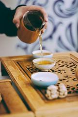 tea master at work (YellowTipTruck) Tags: teaparty bunfight greentea tea crockery dishes pouredtea teagods teatable