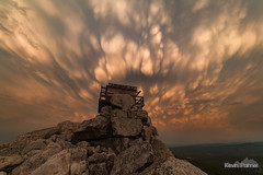 Lookout Above (kevin-palmer) Tags: bighornmountains bighornnationalforest wyoming summer august nikond750 smoky samyang rokinon14mmf28 blackmountain top summit stormy storm thunderstorm evening clouds sunset colorful color orange mammatus firelookouttower rocks boulders scenic view old wooden structure