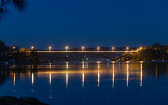 Bridge with Golden Reflections (Merrillie) Tags: lines blackwall landscape bridge water reflections city nighttime newsouthwales homes lights blue brisbanewater vivid australia bay sthubertsisland starbursts nightlights mountains woywoy night nightscape centralcoast ribbridge town gold golden